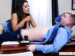Dark haired office sexpot Jynx Maze wanks and blows such a valiant cock