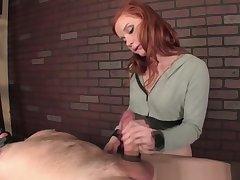 Redhead babe gives perfect femdom handjob