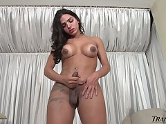 Truly horny transsexual unaffiliated Drika Lima flashes her big bubble ass