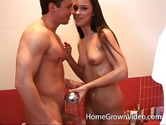 Brunette babe takes a shower with her boyfriend after a fuck