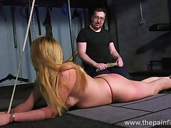 Kinky pervert punishes pussy of one tied up bitch in the dark basement